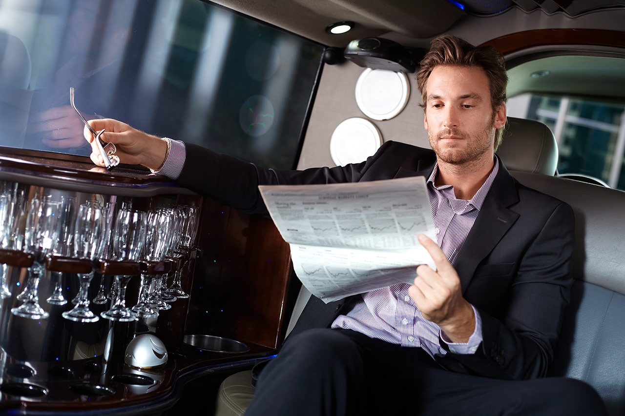 Business traveler in limo/ground transportation
